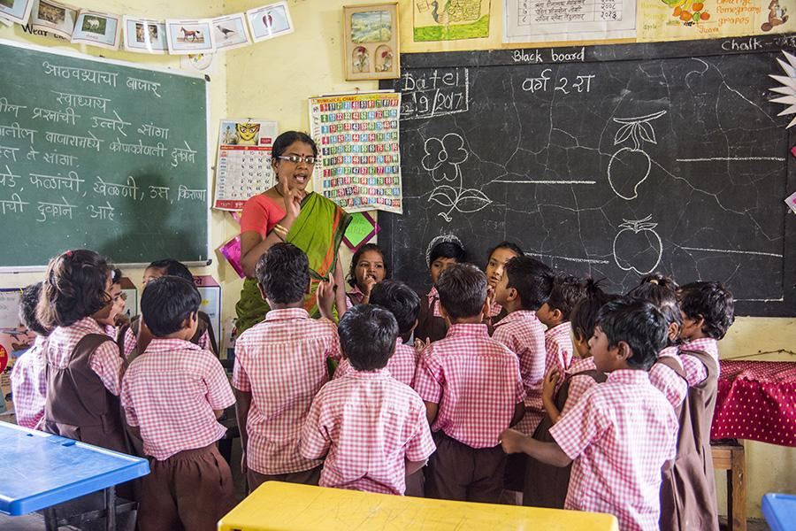 Teacher teaching in government school
