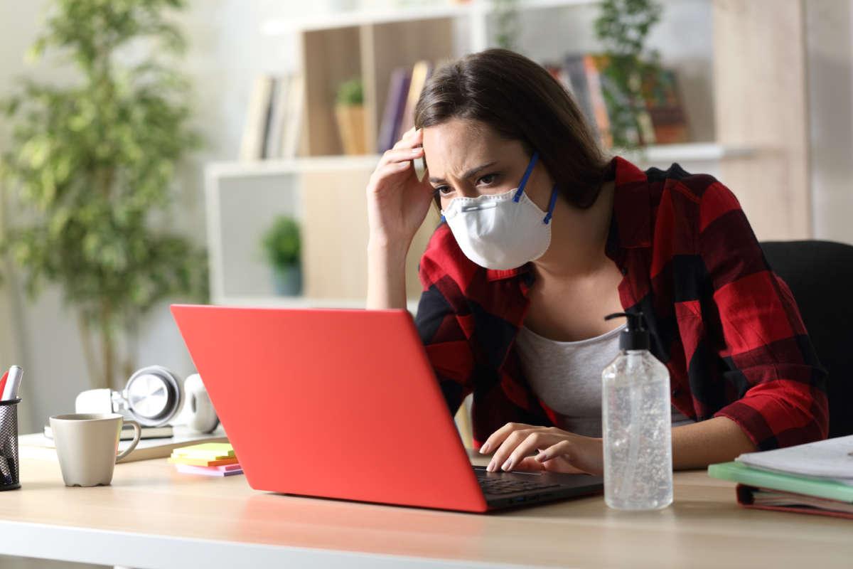 tensed student listening to online class - CollegeMarker